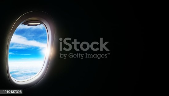 902818356 istock photo Black background with copy space with look of seat window frame of airplane flight see view of sunset clouds, airplane wing, ice mountains for luxury trip tourism travel transportation concept 1210437323