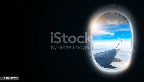 902818356 istock photo Black background with copy space with look of seat window frame of airplane flight see view of sunset clouds, airplane wing, ice mountains for luxury trip tourism travel transportation concept 1210437324