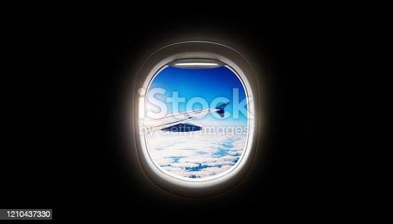902818356 istock photo Black background with copy space with look of seat window frame of airplane flight see view of sunset clouds, airplane wing, ice mountains for luxury trip tourism travel transportation concept 1210437330