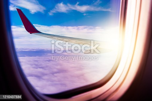 902818356 istock photo Black background with copy space with look of seat window frame of airplane flight see view of sunset clouds, airplane wing, ice mountains for luxury trip tourism travel transportation concept 1210437334