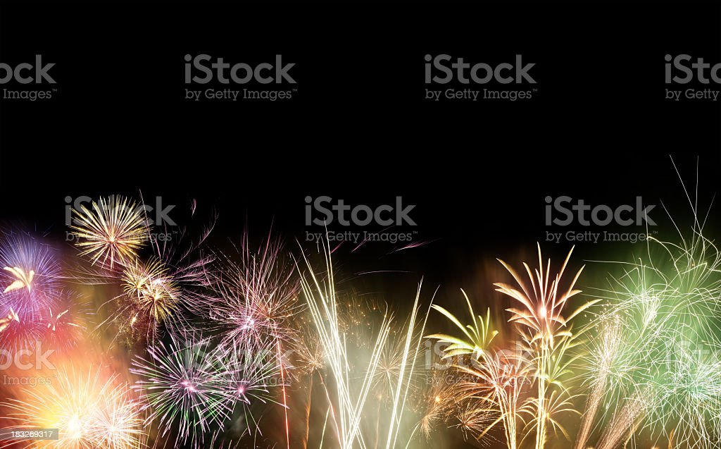 Black background with multi colored fireworks exploding royalty-free stock photo