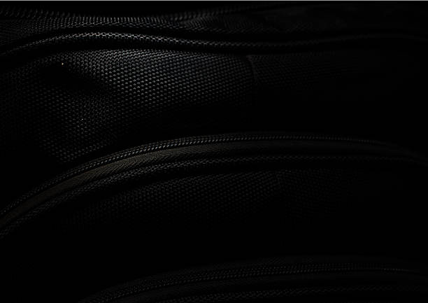 black bag background - nylon texture stock pictures, royalty-free photos & images