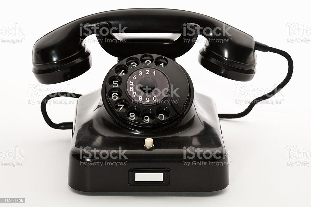 Black bakelite classic rotary phone isolated on white stock photo