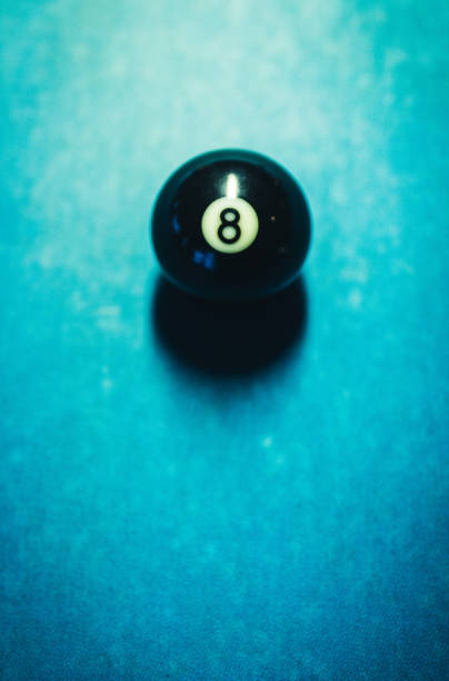 Black ball on the billiard table. Close up. stock photo