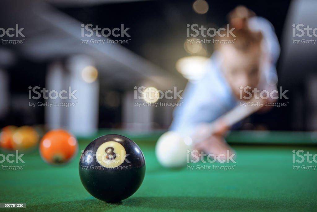 Black ball on the billiard table stock photo