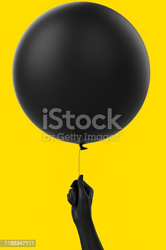 istock Black balloon and hand holding it on yellow. 1155347111