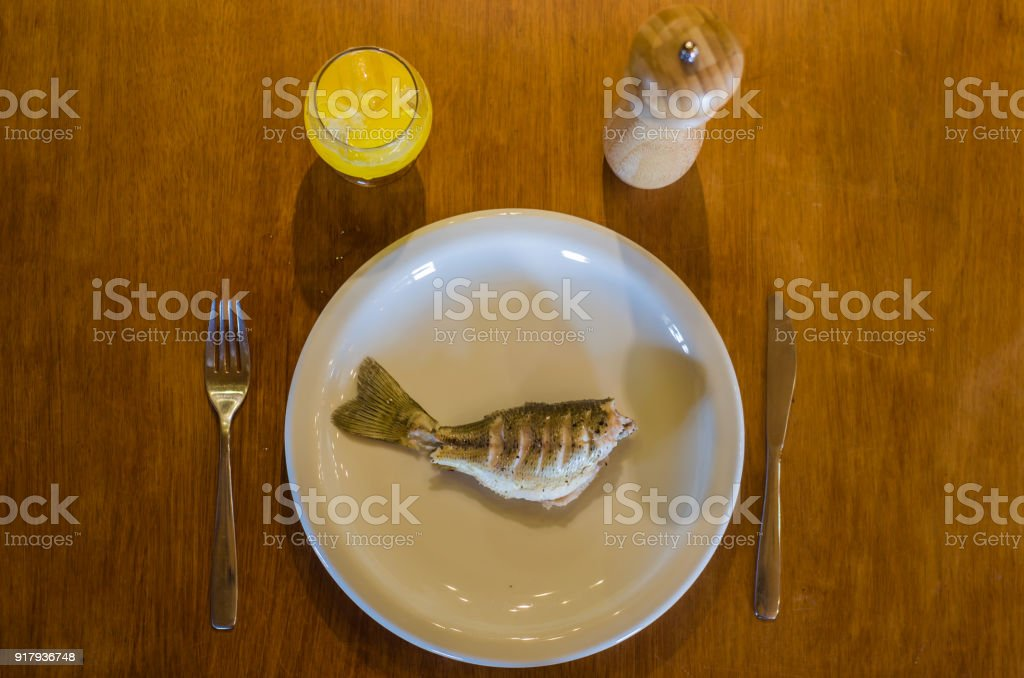Black Bass Fish roasted on the plate stock photo
