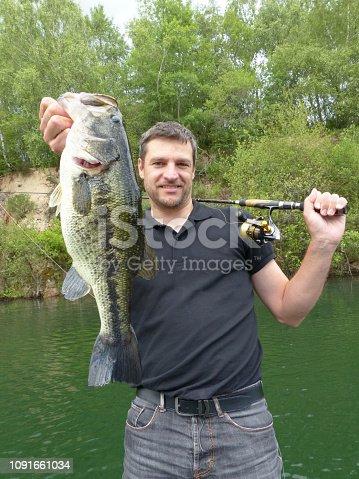 496065234istockphoto Black Bass fishing, catch of fish 1091661034