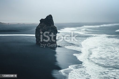 Dramatic black-sand beach Reynisfjara on Iceland.