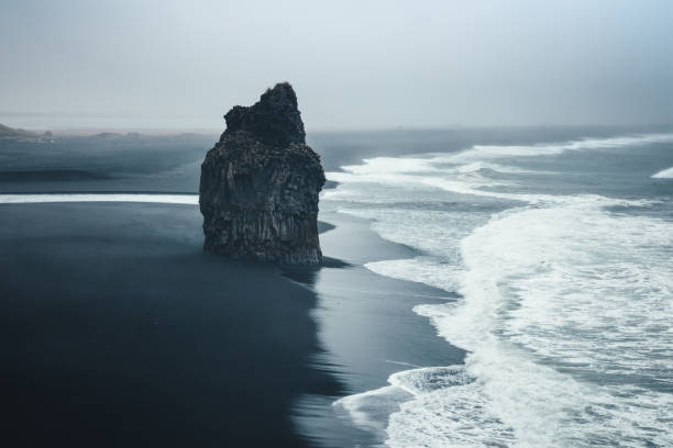 Black Beach Dramatic black-sand beach Reynisfjara on Iceland. coastal feature stock pictures, royalty-free photos & images