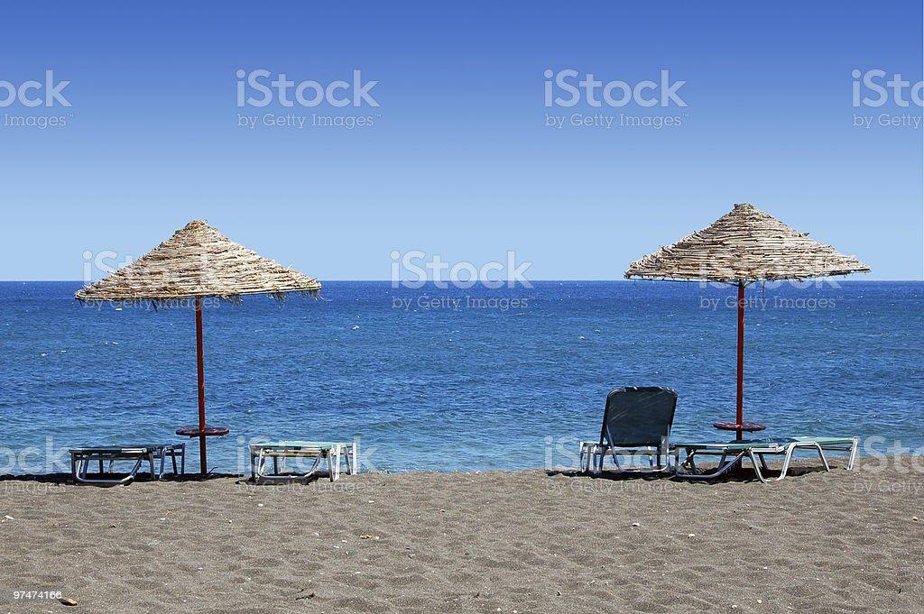 Black Beach Umbrellas - Greece royalty-free stock photo