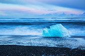 istock Black beach with icebergs 1195192420