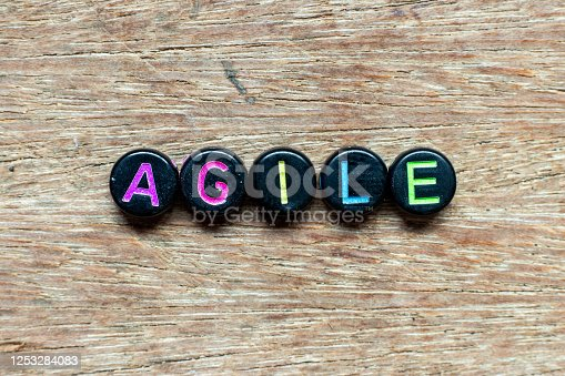 1144568493 istock photo Black bead with color letter in word agile on wood background 1253284083