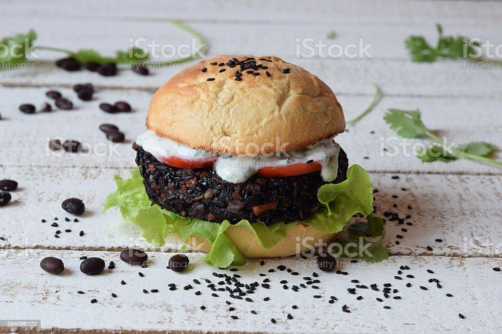 Black bean and black rice burguer stock photo
