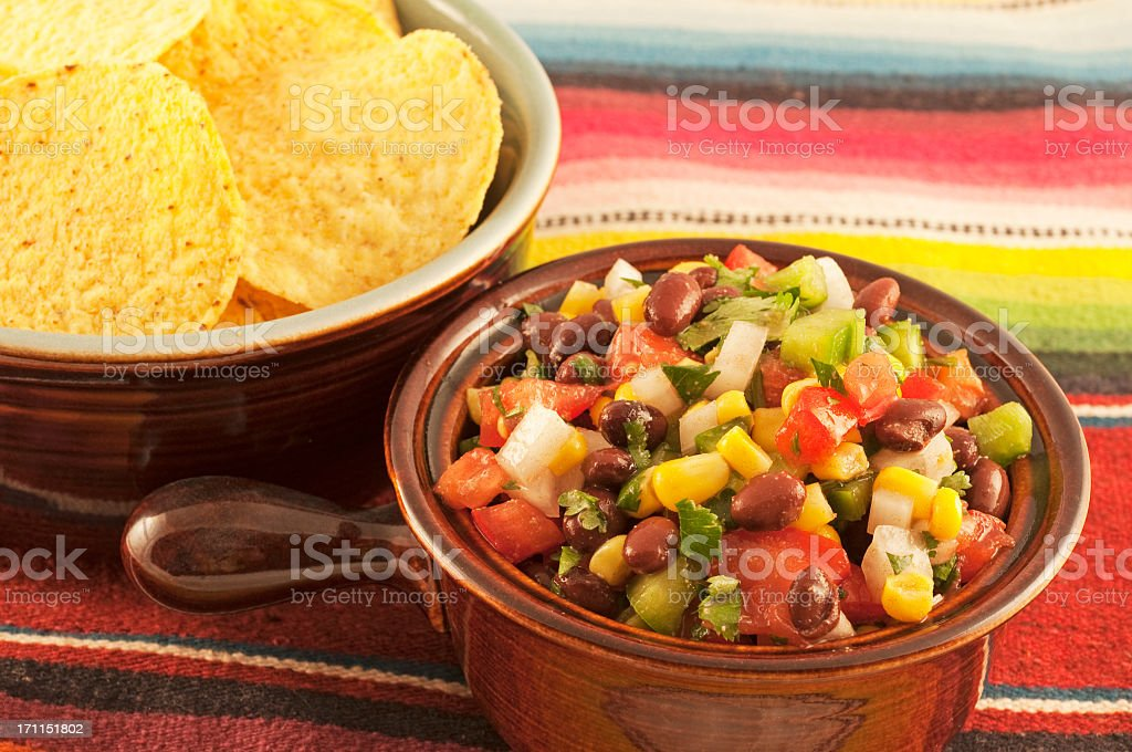 black bean and corn salsa served with tortilla chips stock photo