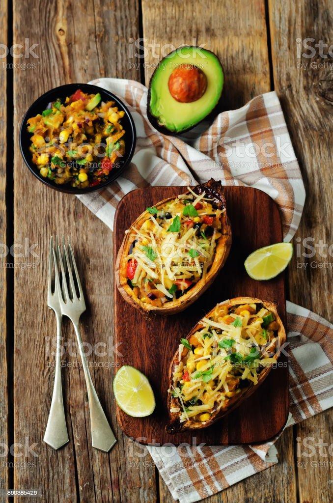 Black bean avocado corn stuffed sweet potatoes stock photo