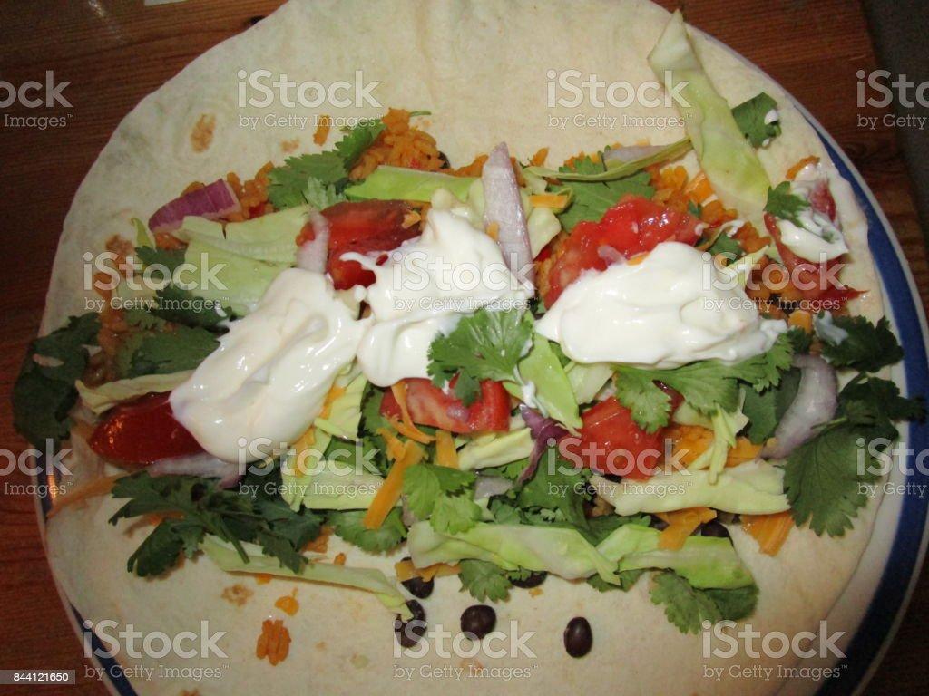 Black bean burrito served for breakfast, lunch or dinner. stock photo