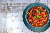 Black bean quinoa sweet potato bell pepper corn chili in a bowl garnish with parsley