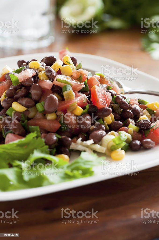 Black Bean Salad on White Plate Vertical stock photo