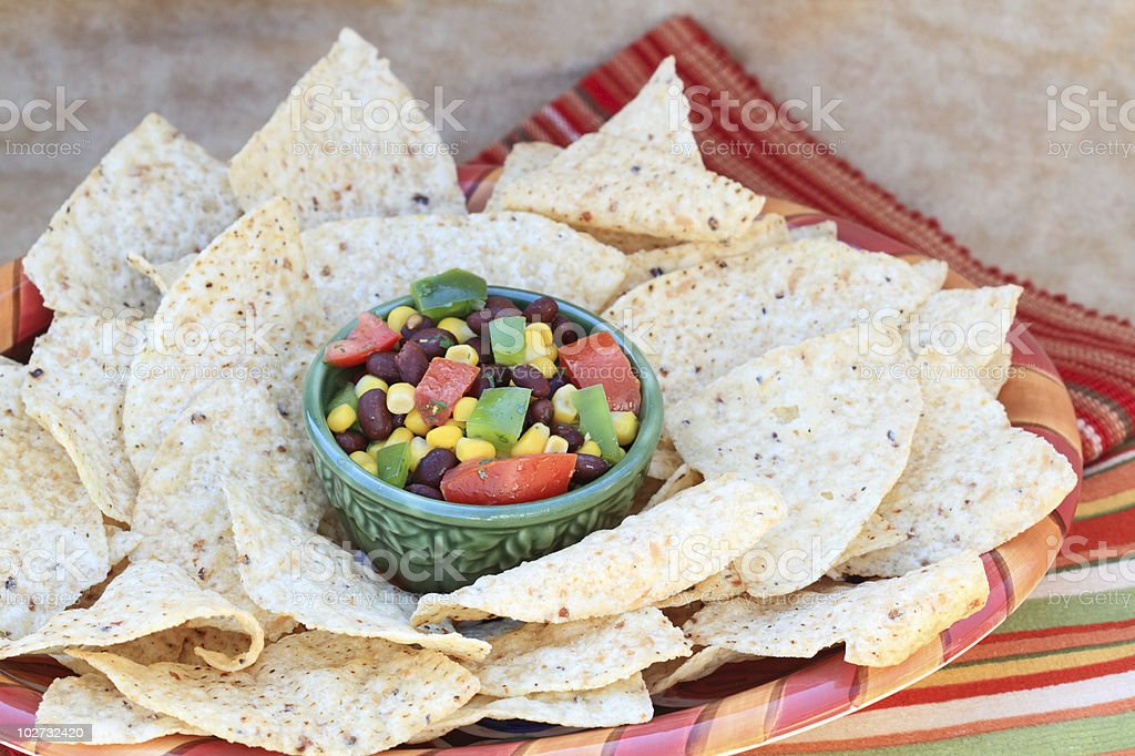 Black Bean Salad with Corn Chips stock photo