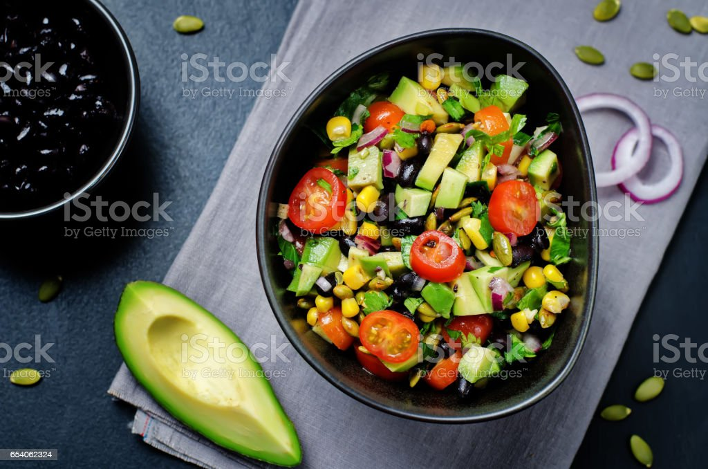 Black beans corn avocado red onion tomato salad with lime dressing stock photo