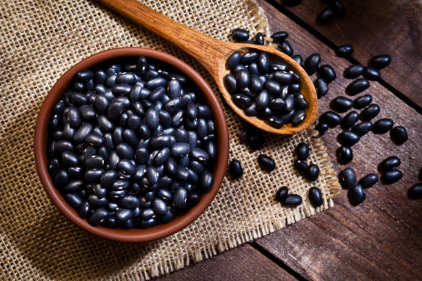 Black beans in a bowl stock photo