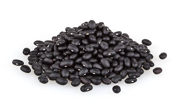 Black beans isolated on white background + clipping path stock photo