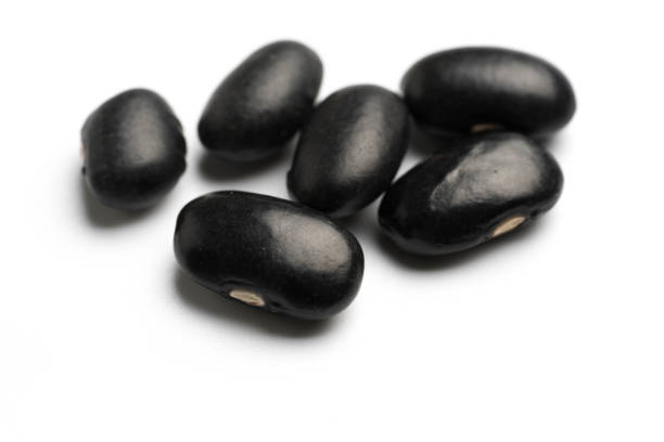 black beans isolated on white background stock photo