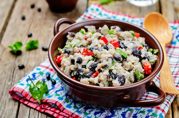 Black beans pepper cilantro cauliflower brown rice stock photo