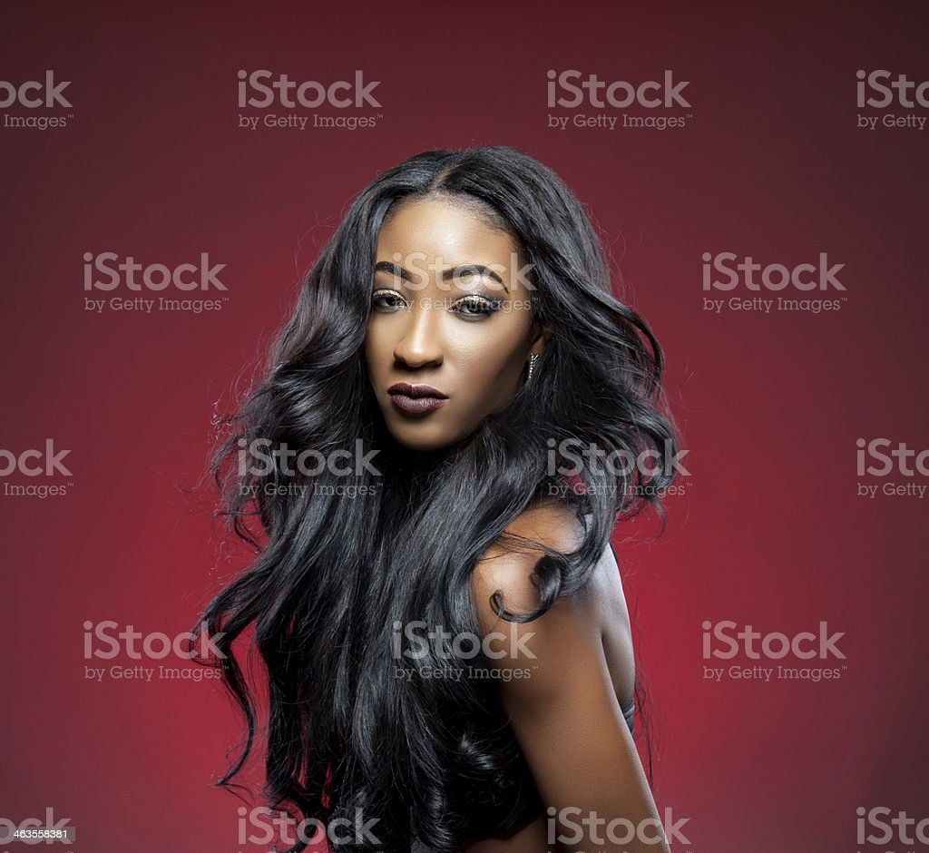 Black beauty with elegant curly hair stock photo