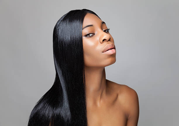 Black beauty with long straight hair Young black beauty with long straight hair straight hair stock pictures, royalty-free photos & images