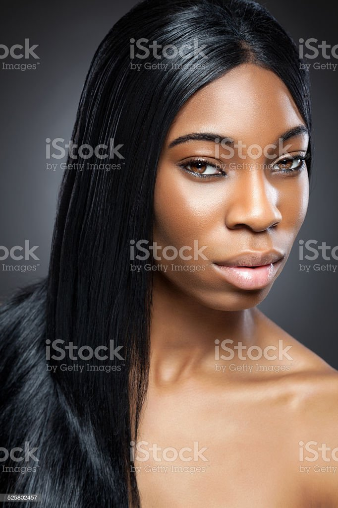 Black beauty with long straight hair stock photo