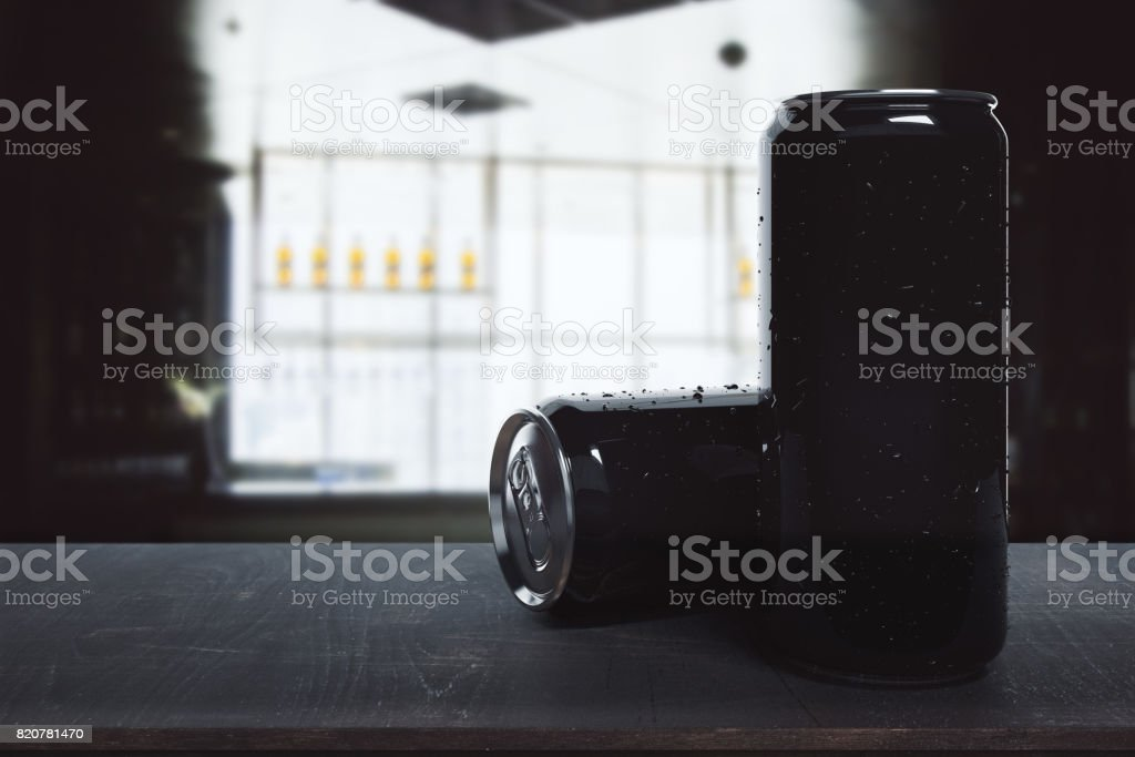 Black beer cans on blurry background stock photo