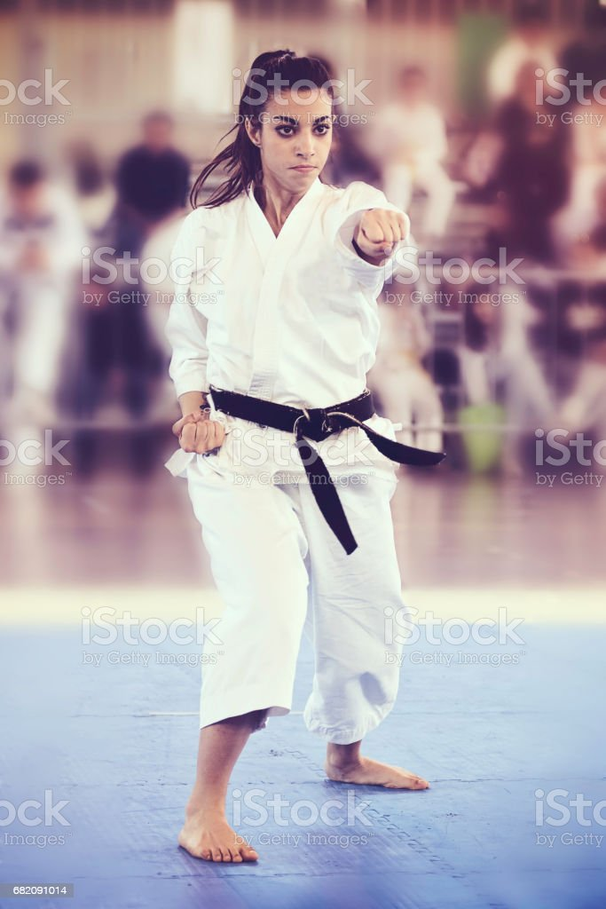 Black Belt 20Y Girl Performing Karate at a Competition stock photo