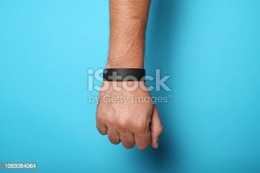 Black blank bracelet on hand. Music festival branding wristband, adhesive paper accessory for concert, event. mockup.