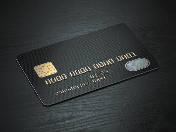 Black blank credit cards mockup on black wood table background. stock photo