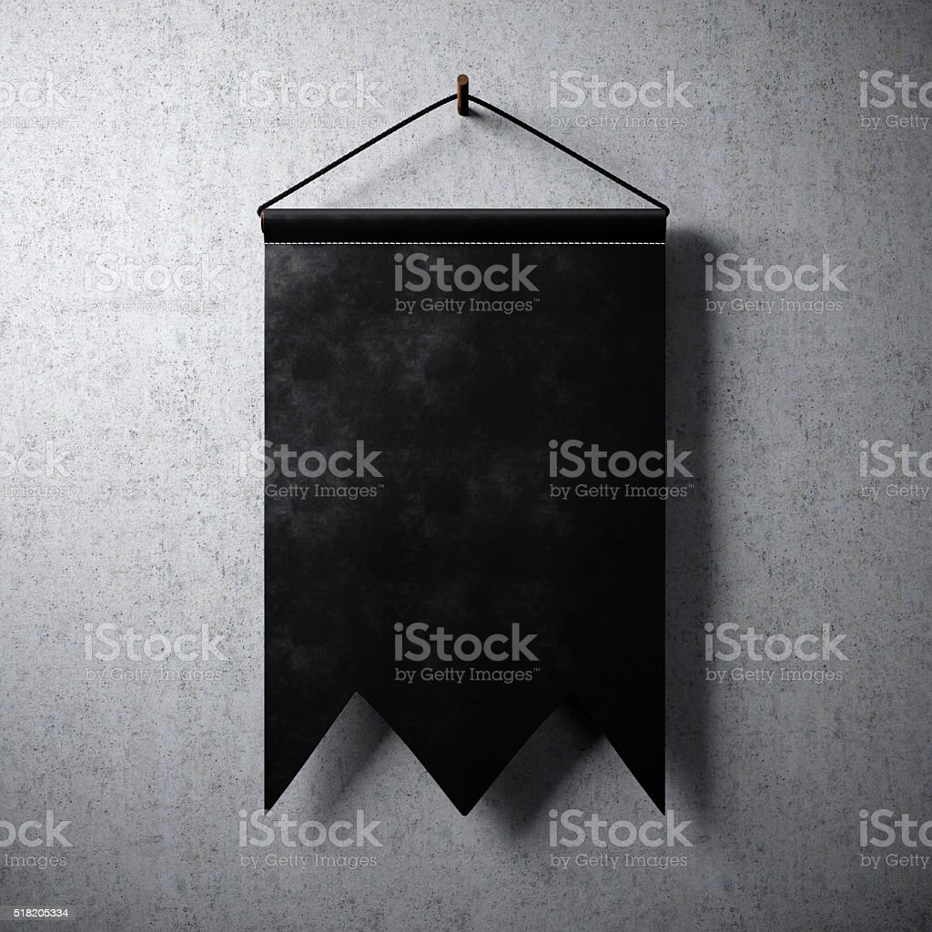 Black blank pennant hanging on concrete wall. Ready for your stock photo