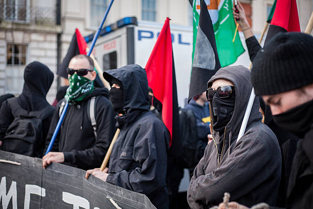 Black bloc protesters at 'Time To Act' climate march stock photo