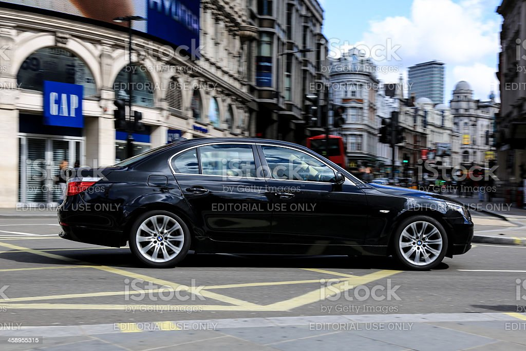 Black BMW Car in Piccadilly Circus, London, UK royalty-free stock photo