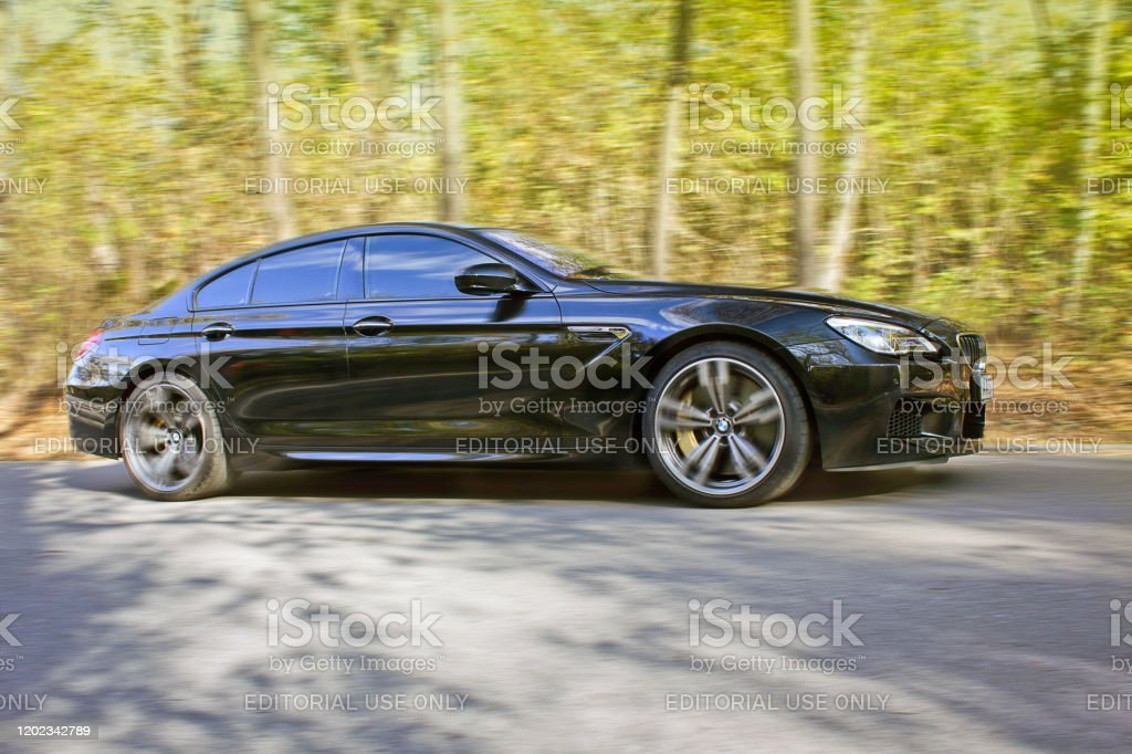 Black Bmw M6 In Autumn Forest Bmw In Motion Stock Photo Download Image Now Istock