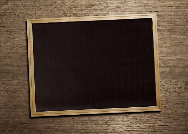 black board on wood table stock photo
