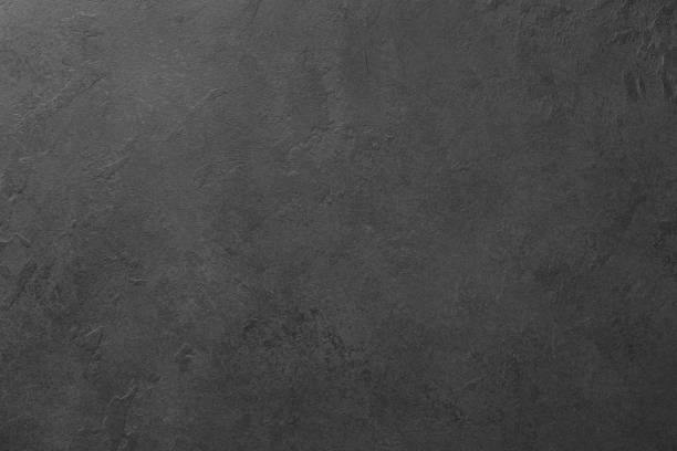 Black board or black stone background texture stock photo