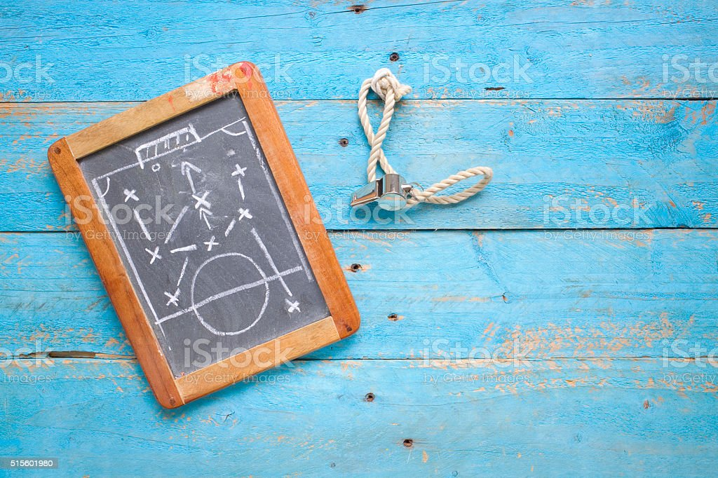 black board with tactical soccer diagram, stock photo