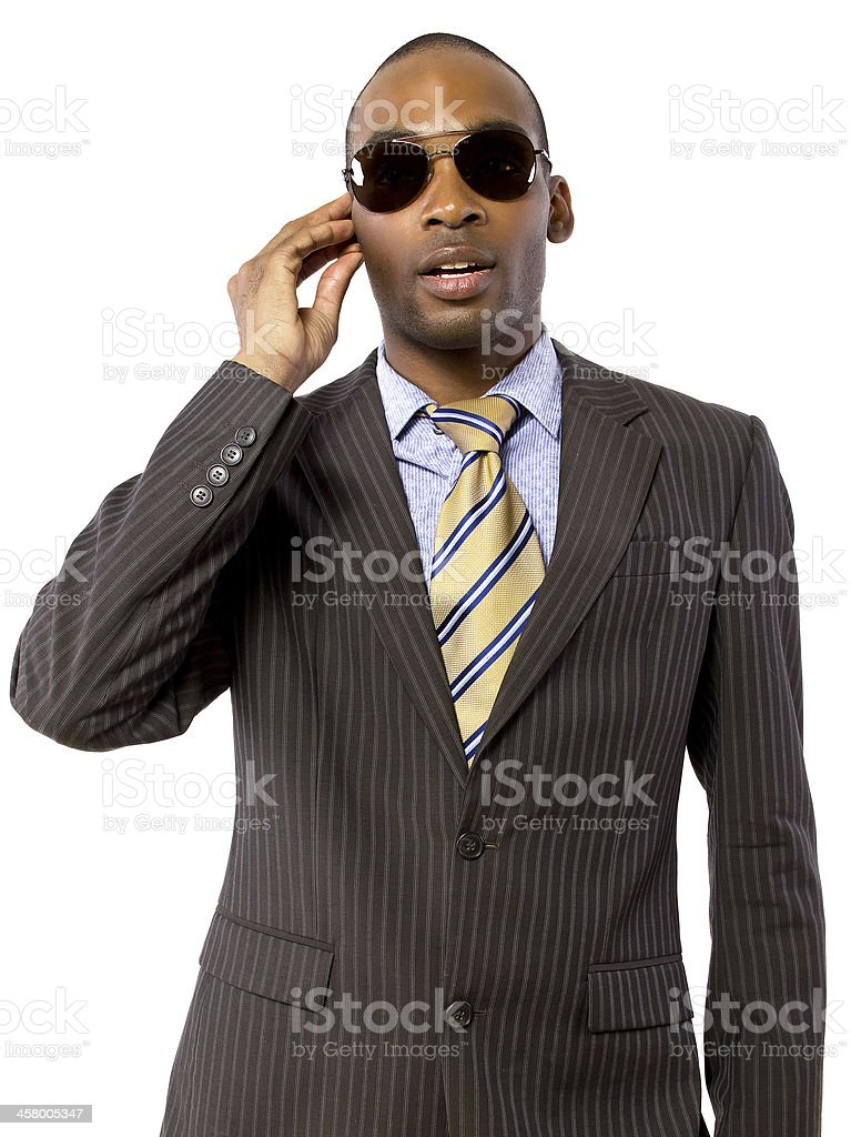 Black Bodyguard Wearing a Suit and Sun Glasses stock photo