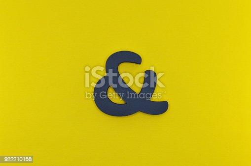 istock black bold ampersand on yellow background 922210158