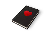 Black book with red velvet heart on white background with outline paths for easy editing.