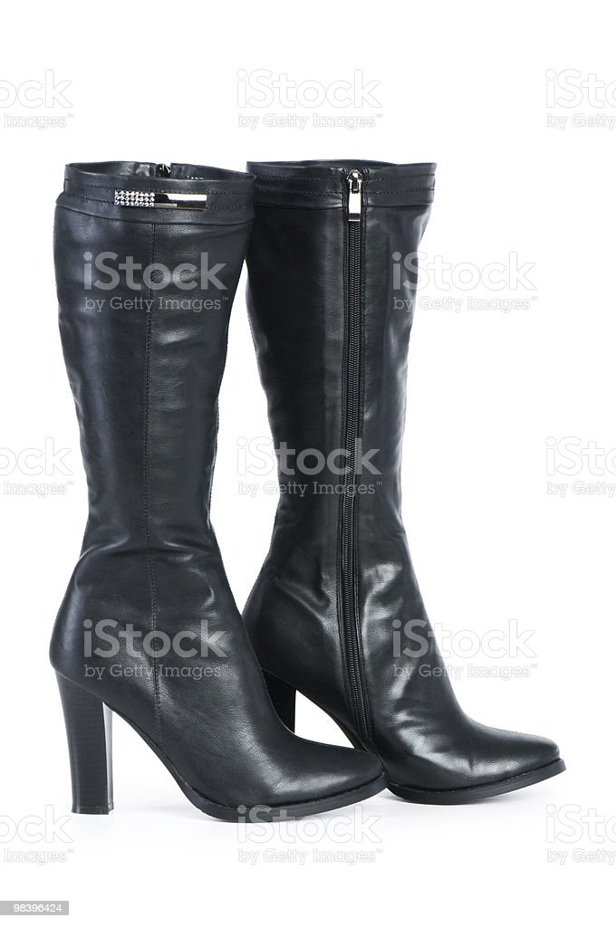 Black boots isolated on the white background royalty-free stock photo