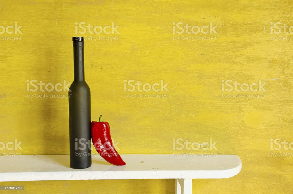 black bottle and red pepper royalty-free stock photo