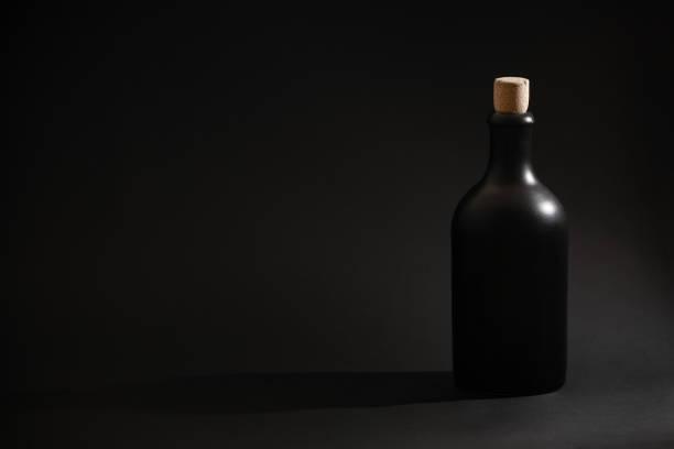 Black bottle of rum or whiskey on a black background picture id1190376053?b=1&k=6&m=1190376053&s=612x612&w=0&h=89zbdlbwpabbzkbrnomvy3a1yc5jqpmv duodcbdynu=