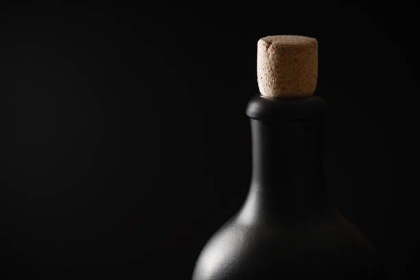 Black bottle of rum or whiskey on a black background picture id1190376090?b=1&k=6&m=1190376090&s=612x612&w=0&h=q yrjh83zzzqpz9dvomth18a4myrgpgodislqiyijou=